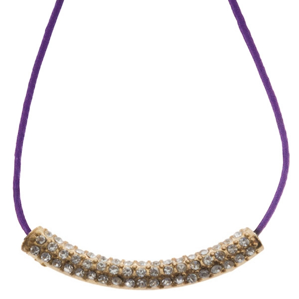 16 inch Purple cord necklace with a gold toned crystal rhinestone focal