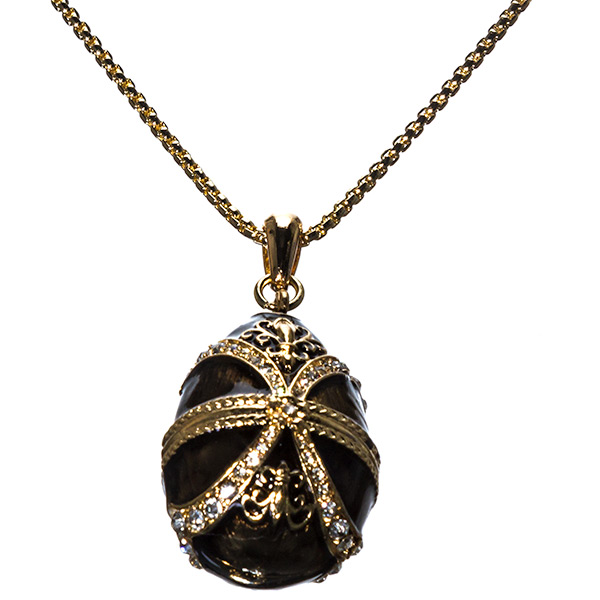 """27"""" gold tone necklace with designer inspired egg charm that has a dark chocolate enamel, filigree Fleur De Lis design and clear crystal rhinestones.  Has a 3"""" extender."""