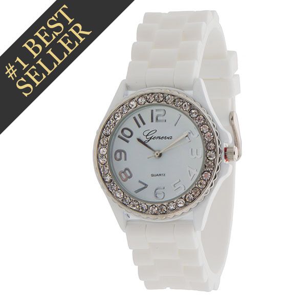 White silicone (stone rubber) watch band with crystal rhinestones over silver tone surrounding the white face with silver tone numbers. Stainless steel back and measures approximately 1.75 inch in diameter.