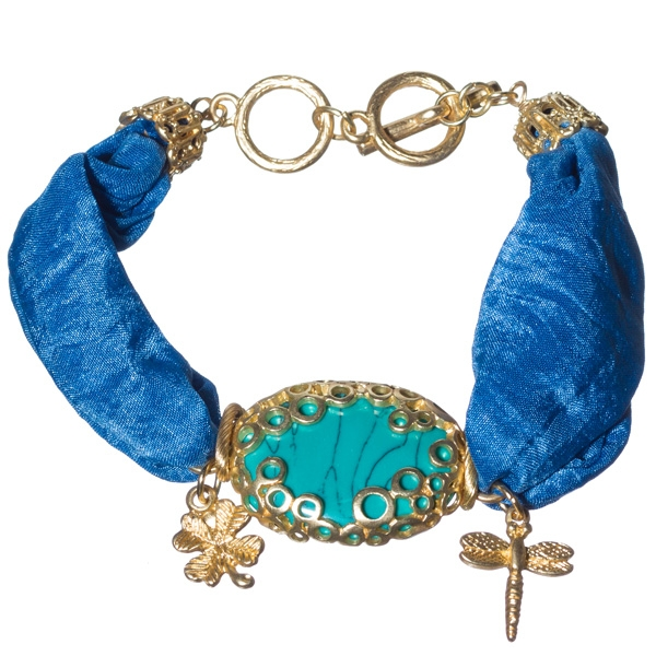 Striking blue, satin ribbon, charm, gold tone toggle bracelet with charms of butterfly and insects and featuring oval turquoise stone focal.