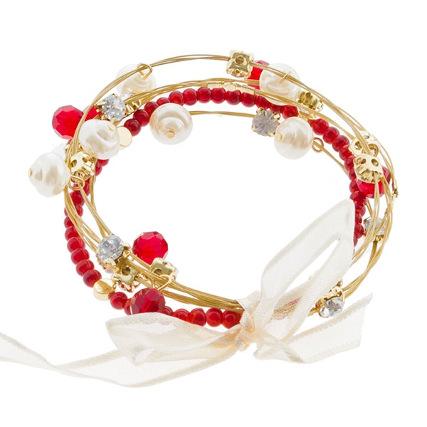 "7.5"" around five strand bracelet featuring red beads, glass pearl and red bead charms, and multi-hued crystal rhinestones. The bracelets are held by a delicate ivory ribbon."