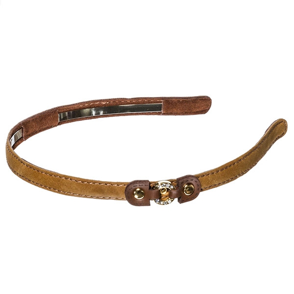 Light brown colored 1inch leather covered metal headband with a small brown leather buckle with a small gold toned crystal rhinestone covered ring focal
